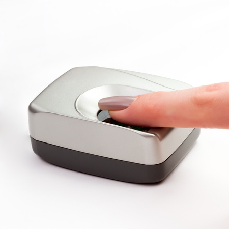 biometric: Finger on a biometric scanner Stock Photo