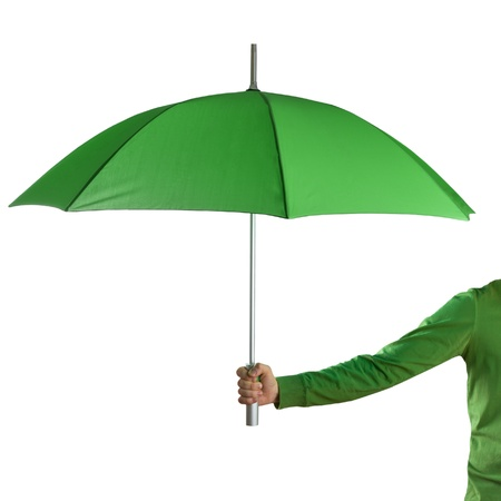 Hand holding a green umbrella isolated on white