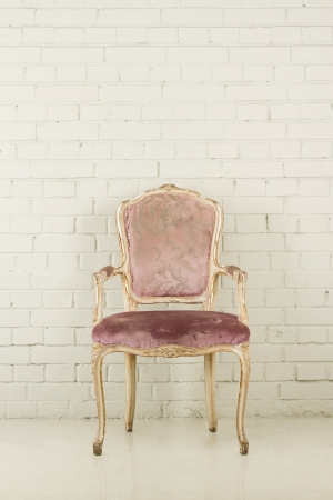 Vintage chair in empty white room photo