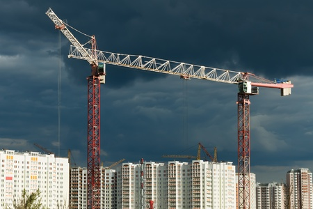 The building construction site. Lifting cranes photo
