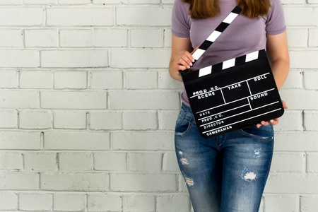 Woman holding a clapboard  photo