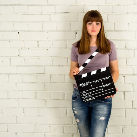 Young girl holding a clapboard  photo