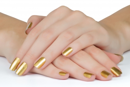 manicured: Manicured golden woman nails on the table close up   Stock Photo