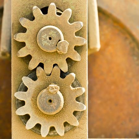meshing: Old metal cog gears meshing together Stock Photo