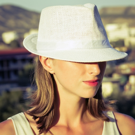 Young woman wearing white hat  photo