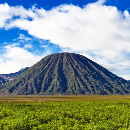 tengger: Volcano against blue sky with clouds  Bromo Tengger Semeru National Park, East Java, Indonesia