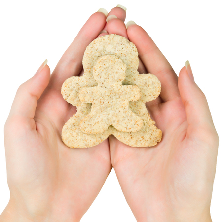 Woman hands holding two gingerbread men cookie  photo