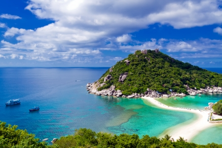 Beautiful tropical island against blue sky with clouds  Koh Phangan island, Kingdom of Thailand photo