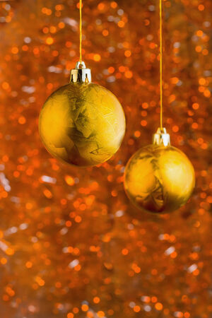 hristmas: Golden Сhristmas balls over beautiful bokeh background with copy-space