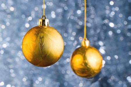 hristmas: Golden Сhristmas balls over beautiful bokeh background