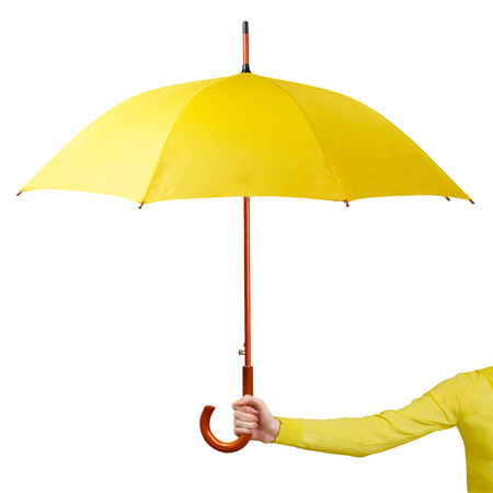 Hand holding a yellow umbrella isolated on white background Stock Photo