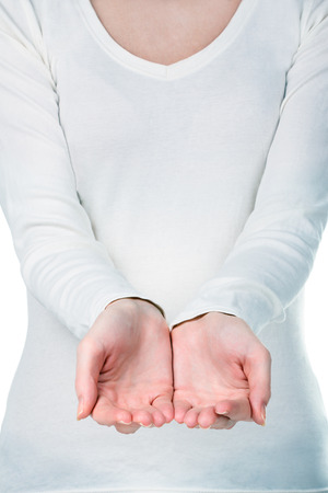 pleading: Young womans hands with copy space