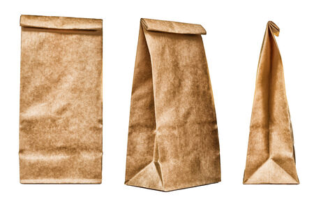 Brown textured paper bag set isolated on white background photo