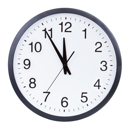 face work: Clock face showing the hands at five minutes to midnight