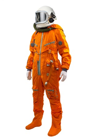 cosmonaut: Astronaut wearing space suit standing against white background.