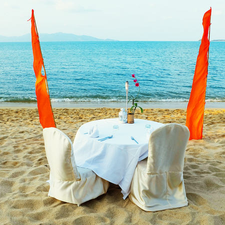 Romantic beach restorant at tropical resort. Dating on the beach photo
