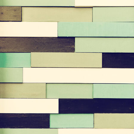 Vintage tiled wooden wall background. Toned image photo