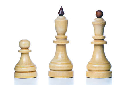 Wooden chess-men isolated on a white background. Pawn, king and queen