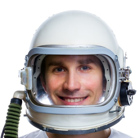 protective helmets: Astronaut isolated on a white background. Man wearing vintage space helmet. Dreaming about space Stock Photo