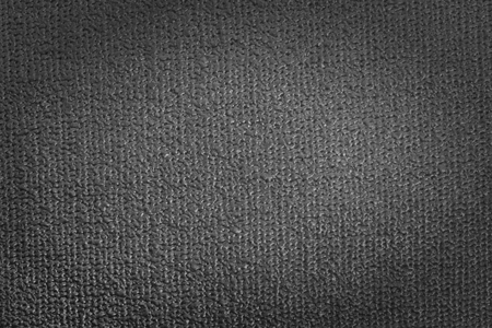 Detail view of yoga mat. Grey background with vignette Stock Photo
