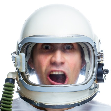 acrophobia: Man wearing vintage space helmet isolated on a white background. Fear of heights. Fear of flying. Aerophobia concept Stock Photo