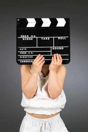 Kid holding clapper board. Cinema concept photo
