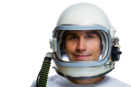 Young man wearing vintage space helmet isolated on a white background. Dreaming about space concept