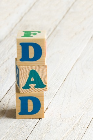Dad sign. Wooden blocks on a white wooden background with copy-space photo