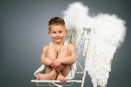Happy angel kid with white wings photo