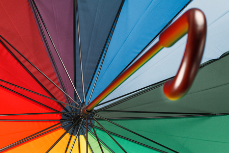 Rainbow colored umbrella photo