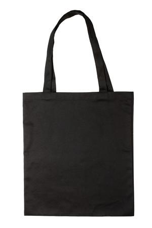 白い背景で隔離の黒い生地のバッグ