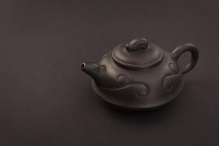chinese tea pot: Chinese tea pot on a black background Stock Photo