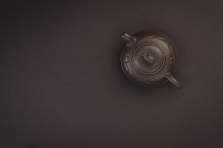 chinese tea pot: Chinese tea pot on a black background.  Overhead view
