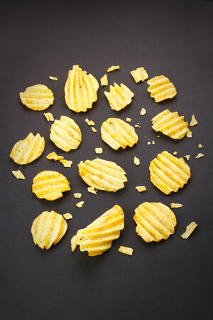 channeled: Potato chips background, top view Stock Photo
