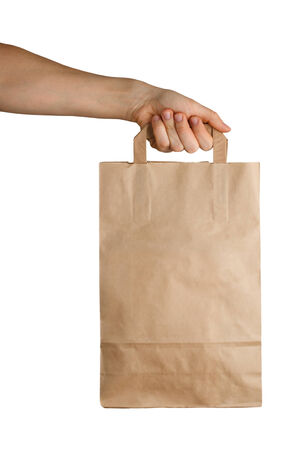 Mans hand holding a paper bag isolated on a white