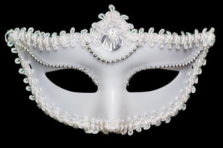 masquerade mask: White mask on a black background