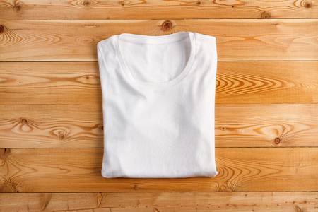 White t-shirt on a wooden background