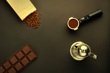 coffeebeans: Coffee espresso in a holder, coffee-beans, bar of chocolate, coffee-pot Stock Photo