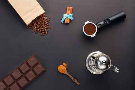 coffee pot: Coffee espresso in a holder, coffee-beans, bar of chocolate, cinnamon, coffee-pot