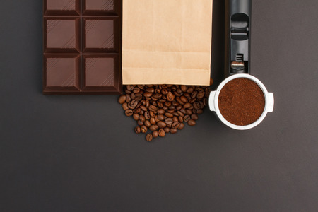 coffeebeans: Coffee background - espresso in a holder, coffee-beans and a bar of chocolate