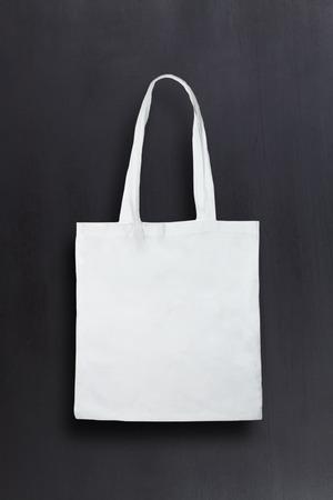White fabric bag against chalkboard background