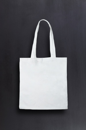 fashion bag: White fabric bag against chalkboard background