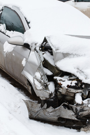 Crushed car in winter photo