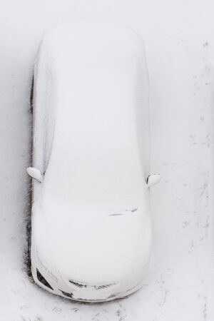 oudoors: Car under the snow - view from above Stock Photo
