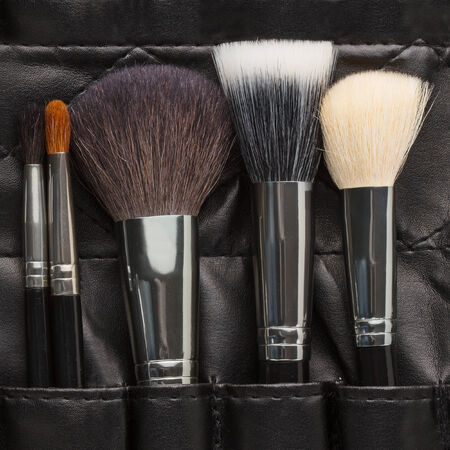Makeup brushes in a makeup artist belt photo