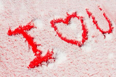 i love you sign: I love you sign on snowed red car Stock Photo