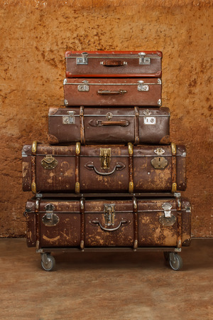 Pile of vintage suitcases. Vintage travel luggage 版權商用圖片
