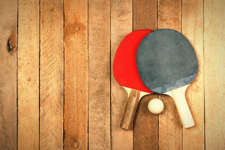 play tennis: Table tennis paddles and ball on wooden texture with copyspace Stock Photo