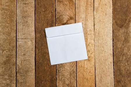 White envelope on a vintage wooden background photo