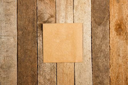 Brown envelope on a vintage wooden background photo